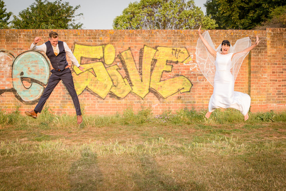 bride-and-groom-jumping-with-joy.jpg