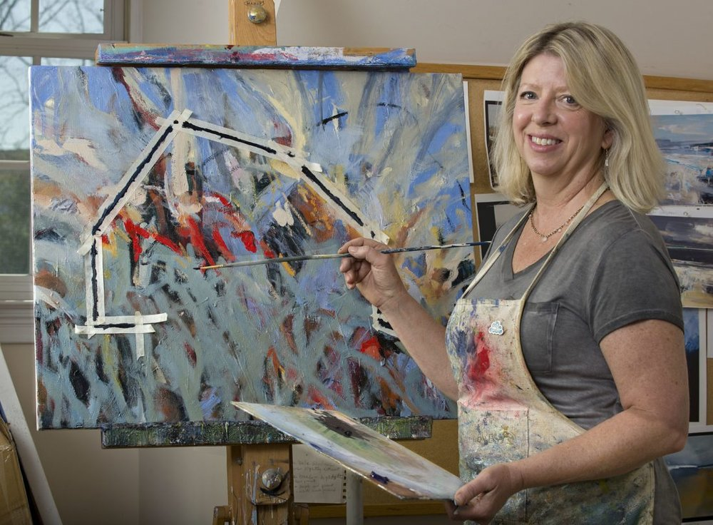"Artist Sally Veach paints her latest barn painting titled ""The Burning 2"" inside her home studio in Woodstock. Veach uses her abstract expressionism style in this oil and acrylic medium. She is showing her art work at the Barns of Rose Hill in Berryville. Rich Cooley/Daily"