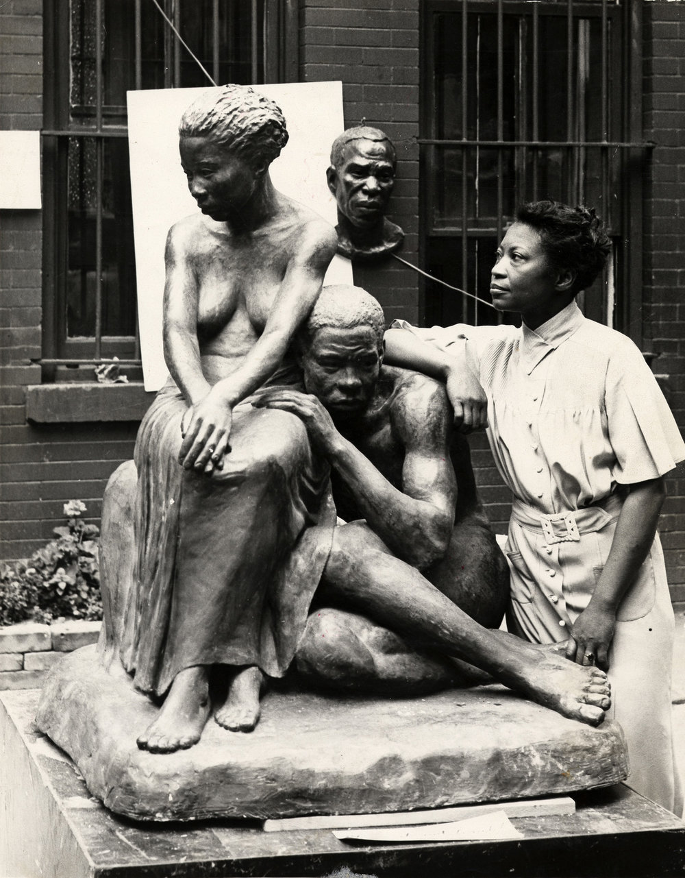 augusta-savage-with-one-of-her-sculptures_around-1938.jpg
