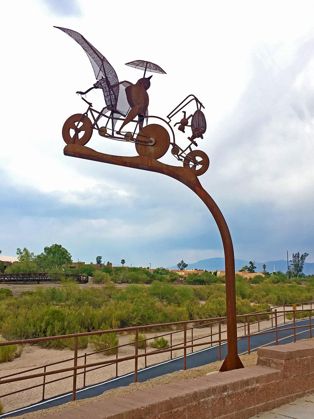 BATTY BIKER  Stephen Fairfield, 2015. Steel, Campbell Ave. at Rillito River Path, Tucson, AZ.