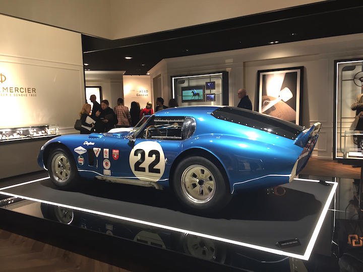Baume & Mercier SIHH 2017 exhibition space, with the famed Coupe — and Peter Brock, designer, of the famed car also was at the show.
