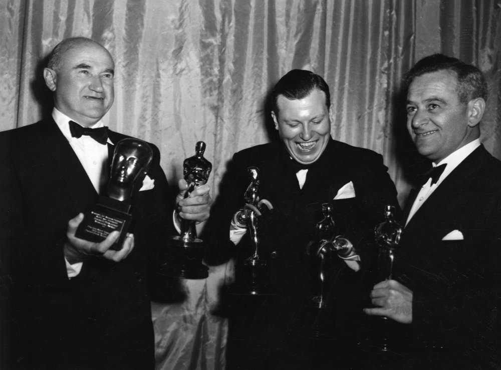 Best Picture and Irving G. Thalberg Memorial Award recipient Samuel Goldwyn, Supporting Actor and Special Award recipient Harold Russell and Best Directing winner William Wyler