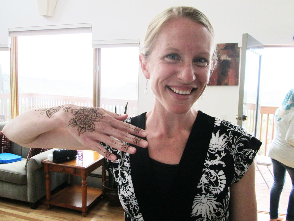 Showing off henna artwork created by a woman who volunteered her skills at the fundraiser