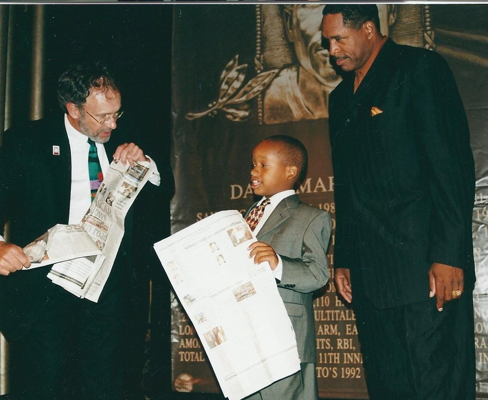 "Hondo's former Attucks-Brooks American Legion baseball teammate Dave Winfield and son at the Hall of Fame induction party in NYC, 2001. Little David Jr is now 6'9"" and looks downward to see his dad.  Now THAT'S magic!"