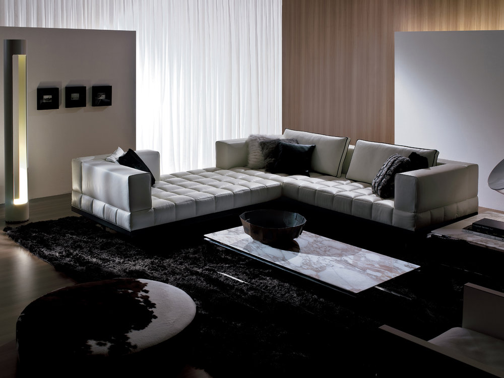 Grid ------------------------------------------- A modular custom made sofa, produced by assembling the various available elements; Six seating platform, five backs, and arms in various lengths $399.99