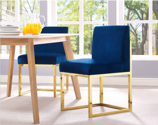 Velvet Chair -------------------------------------------------- Feel comfortable with this haunted chair with navy upholstery the goldtone stainless steel frame contrasts beautifully with the navy upholstery and provides strength and durability $169.99