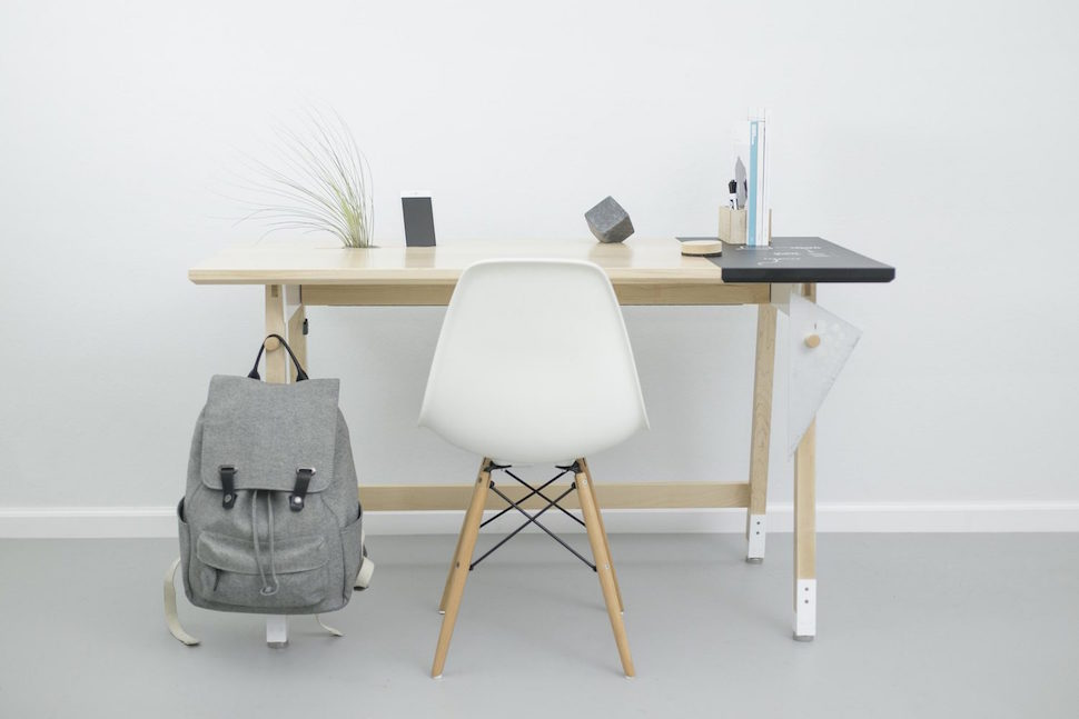 Stand Out Hinged Desk ----------------------------------------------------------- With a laptop on the side, and hooks on the leg you can do your belongings nearby $135.99
