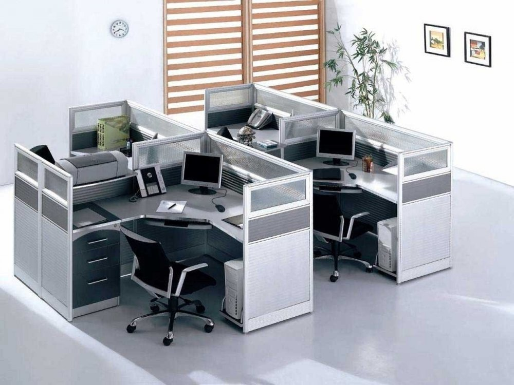 Quad Desk ----------------------------------------------------------- The clear glass walls of this cubicle break the boundary of secluded working spaces $499.99
