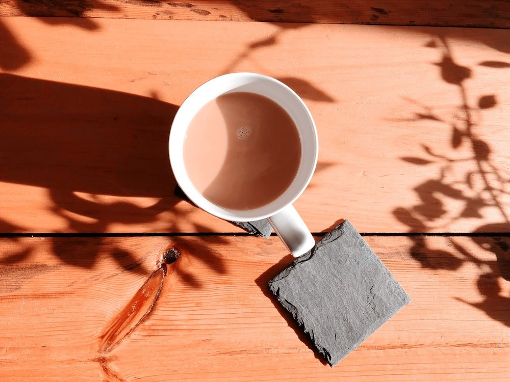 slate coasters i had to grab for my rustic coffee table (find them   here  ).