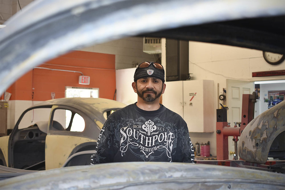 Ricardo, Porsche body man, fabricator and painter at Vintage Sportscar Restorations in Phoenix, Oregon.
