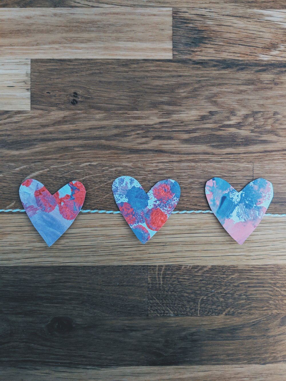 Pom Pom Painting DIY Heart Garland Activities for Toddlers www.momentswithmiss.com 11.jpg