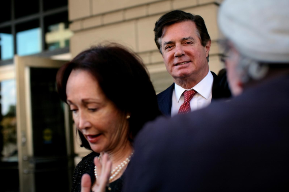 Paul Manafort, former U.S. President Donald Trump 2016 campaign chair (R), departs after a status conference at the U.S. District Court following his indictment on tax fraud and money laundering charges in the special counsel's investigation into alleged Russian meddling in the 2016 U.S. presidential election in Washington, U.S. November 2, 2017. Also seen is Manafort's wife Kathleen (L). REUTERS/James Lawler Duggan