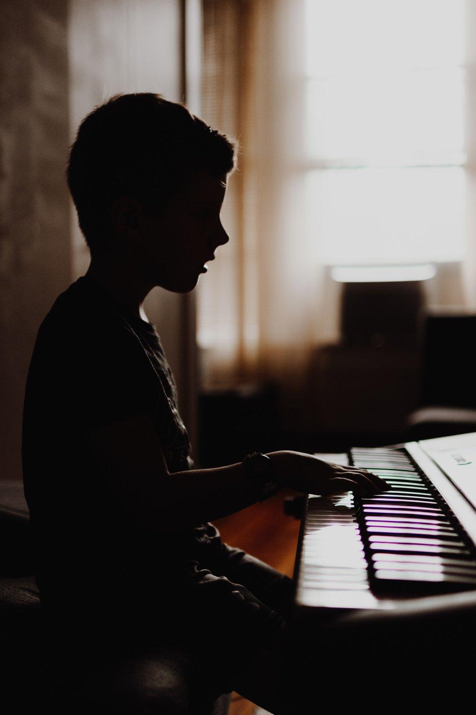 boy-silouette-piano-kelly-sikkema-801485-unsplash.jpg