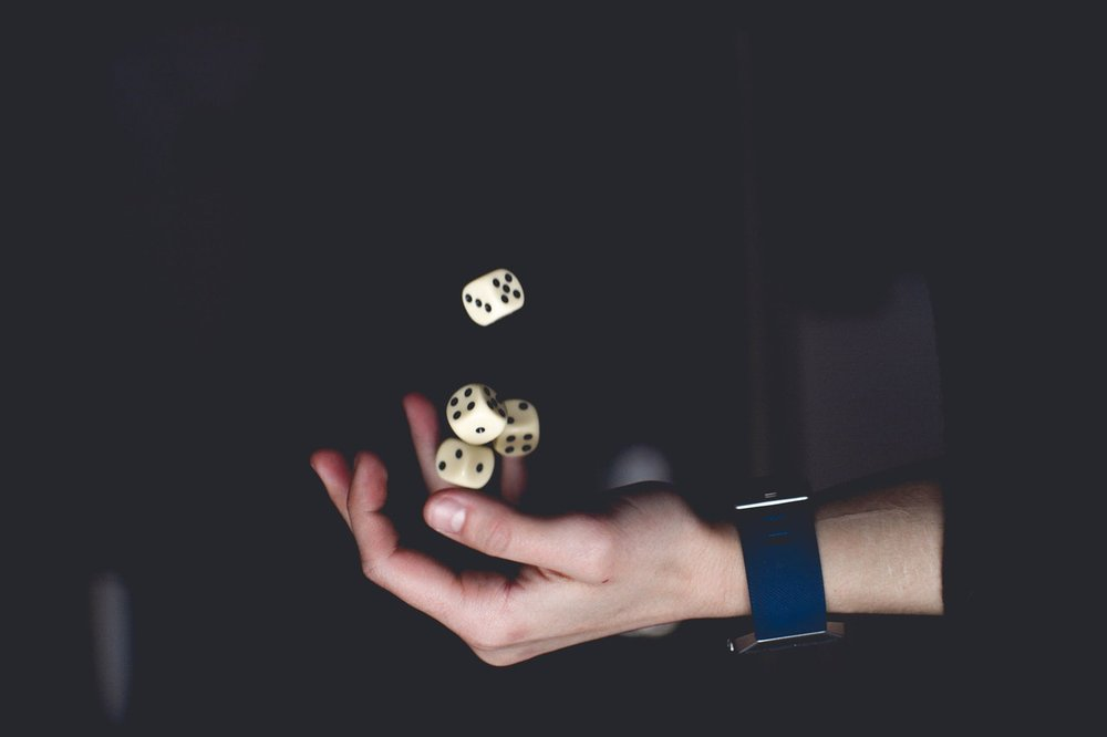 hand catching dice-pexels-photo-1111597.jpeg