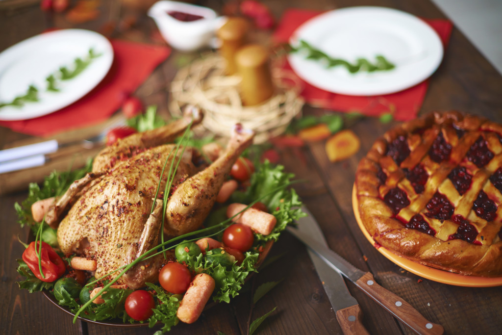 Homemade pastry and roasted poultry on festive table