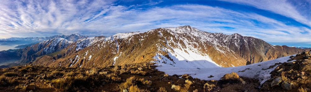 This panoramic shot was taken from Cerro La Cruz and shows from left to right; Cerro Provincia, Cerro El Tambor, Cerro San Ramon, Cerro Punta De Damas.  This is the ridge of the 3 day Sierra San Ramon Traverse.  It's a truly beautiful place and a technical climb/scramble to reach to this point.