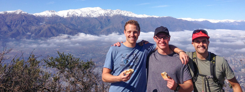 Matt Will and I, they were posing with some tasty Empanadas... Our smiles say it all!  It was nice to feel the sun on our skin after a few days of overcast weather.  Cerro Manquehue is always fun and the views are great.