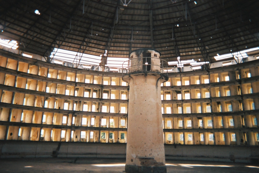 The Panopticon, a type of institutional building designed in the late 18th century, allowed all inmates of an institution to be observed by a single watchman without the inmates being able to tell whether or not they are being watched. Although it is physically impossible for the single watchman to observe all cells at once, the fact that the inmates cannot know when they are being watched means that all inmates must act as though they are watched at all times. Our design takes advantage of this concept to make each customer at a cluster of kiosks feel they are being given personal attention from a single clerk.
