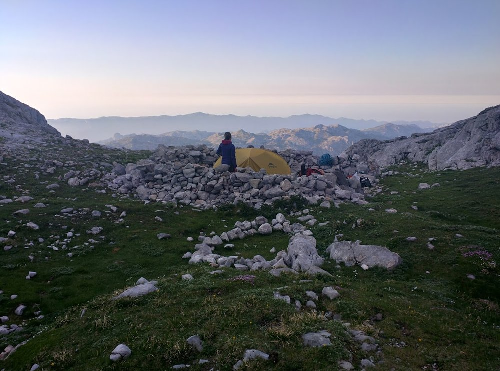 No camping (officially) allowed - but there's perfect, rock ringed tent pads.