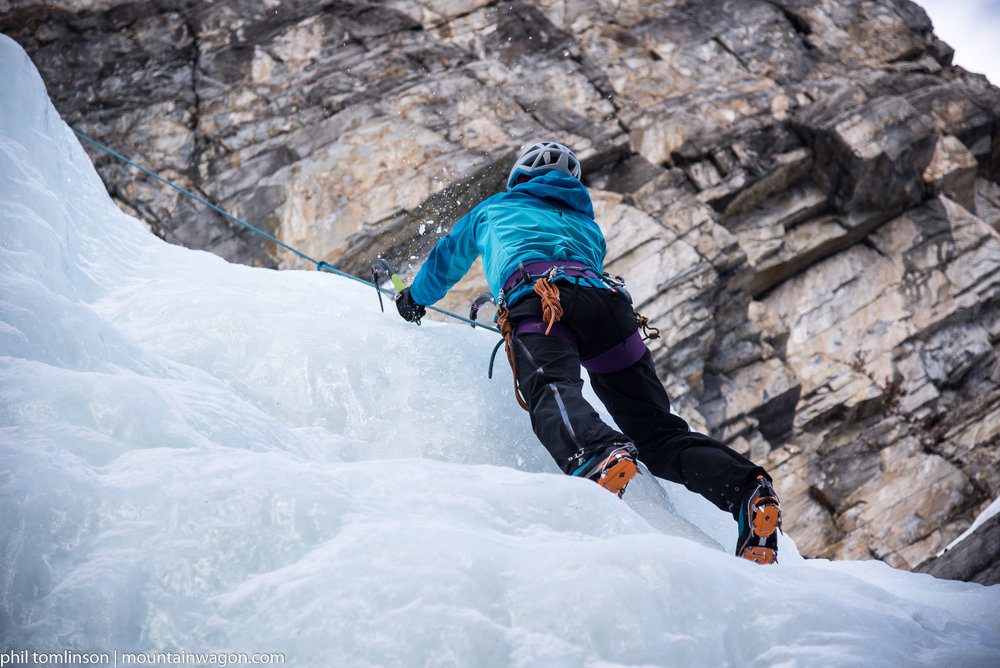 Katherine climbing in an 'honest compromise' jacket - the Arc'teryx Alpha Comp. The lighter blue areas are softshell.