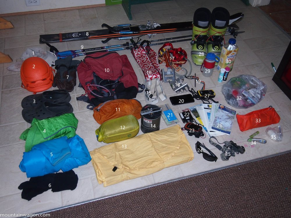 The gear. More than you'd expect. 1. Hat 2. Petzl Sirocco Helmet 3. Crocs 4. 3/4 Length Synthetic Puffy Pants 5. Synthetic Puffy Jacket 6. Spare Socks 7. Gloves 8. Skis with tele-tech bindings 9. Poles 10. MEC Alpine-Lite 35L pack 11. Repair Kit 12. Down Quilt 13. Neo Air X-Lite Sleeping Pad (folded to fit in the pack's back panel slot) 14. MSR Reactor Stove (minus the lid) 15. Skinny Skins 16. Fat Skins 17. Crevasse Self Rescue Kit and Home-Brew Harness 18. Ski Crampons 19. Home-Brew Whippet Ski Pole Attachement 20. Cell Phone 21. 'Wallet' 22. Compass. 23. Garmin e-Trex GPS 24. Sunglasses 25. Zebralight H600 Headlamp 26. Maps 27. inReach 28. Scarpa F1 Boots 29. Water Bottle 30. More Water 31. Nuun Tablets 32. 1.8 Kg Snacks 33. Snack Pouch (attaches to hip belt for refueling on the move) 34. Lip Balm and Tooth Brush 35. Sunscreen.