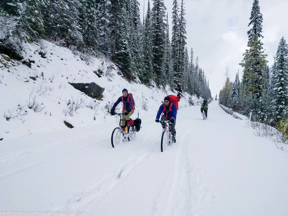 Nothing to see here, just people riding bikes through nearly hub-deep snow...