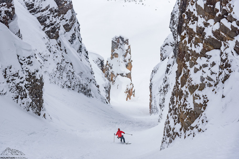 Skyler charging towards the gendarme that guards the mouth of the Grand Daddy couloir