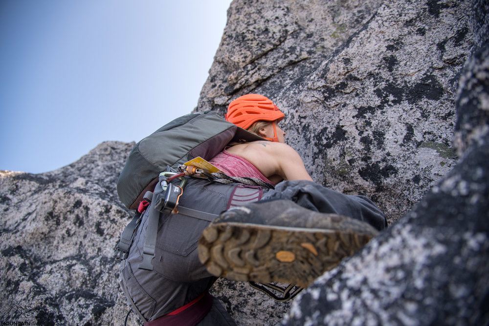Tash scrambling up to gain the ridge