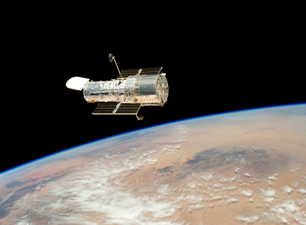 Hubble was designed to be serviced by the space shuttle.  There were 5 servicing missions and, although we don't have the shuttle for more missions, Hubble is continuing to going strong just above us.  This is an image from the final release in 2009.  Credit: NASA