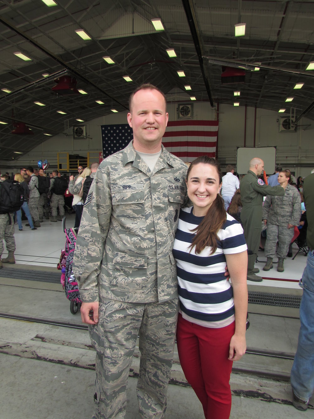 Jenna and now husband, Brandon, at Truax Air Force base in Madison, when they welcomed his brother home from a deployment