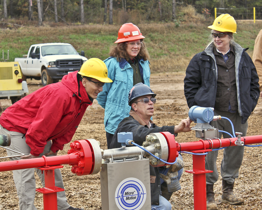 Hovorka, right, and team monitor injected CO2 at field site. Credit: Hovorka lab.