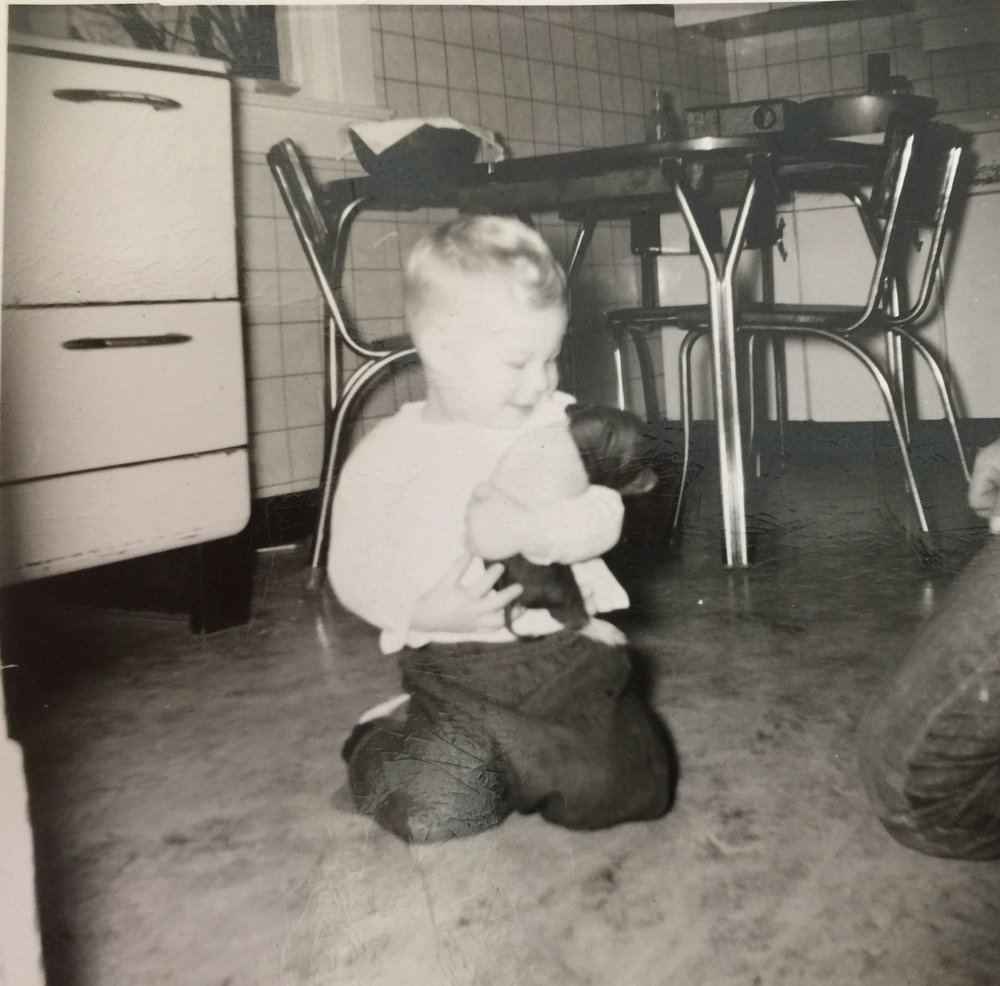 Russ as a child, playing with a piglet. Credit: author.