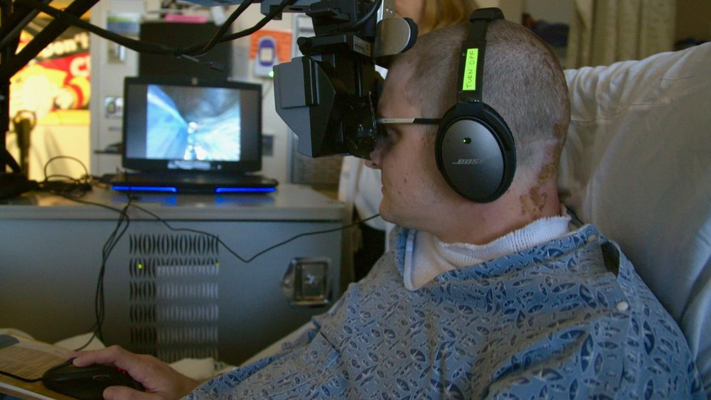 Burn patient Kevin Walsh immerses himself in virtual reality during a burn debridement session.