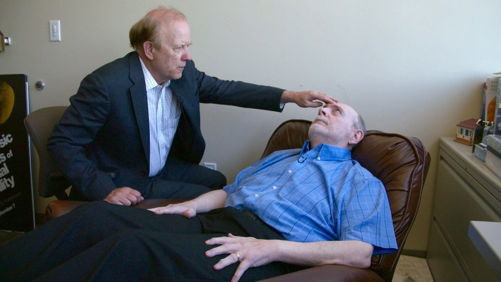 Tim Clark undergoes a hypnosis session with Dr. David Patterson.