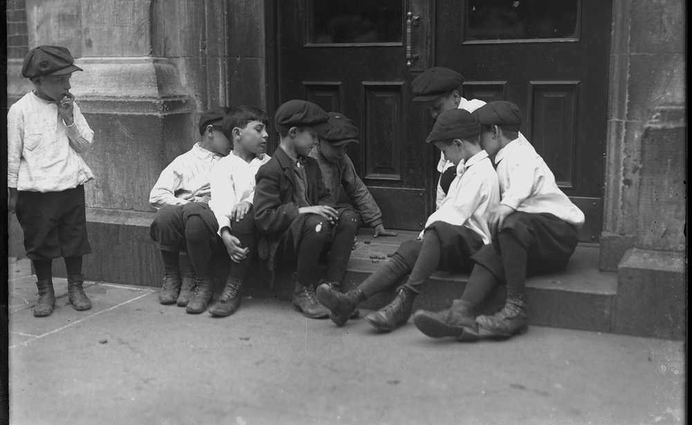 Boys playing checkers on a stoop, probably the Lower East Side, New York City, undated (ca. 1915)..jpg