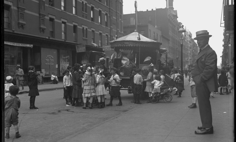 Children gathered around a street carousel, probably the Lower East Side, New York City, undated (ca. 1915)..jpg