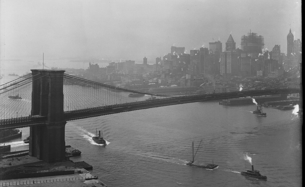 High-angle shot of the Brooklyn tower of the Brooklyn Bridge, the East River, and lower Manhattan, August 25, 1914. Shot from the Brooklyn tower of the Manhattan Bridge. Part 1 of a panorama..jpg