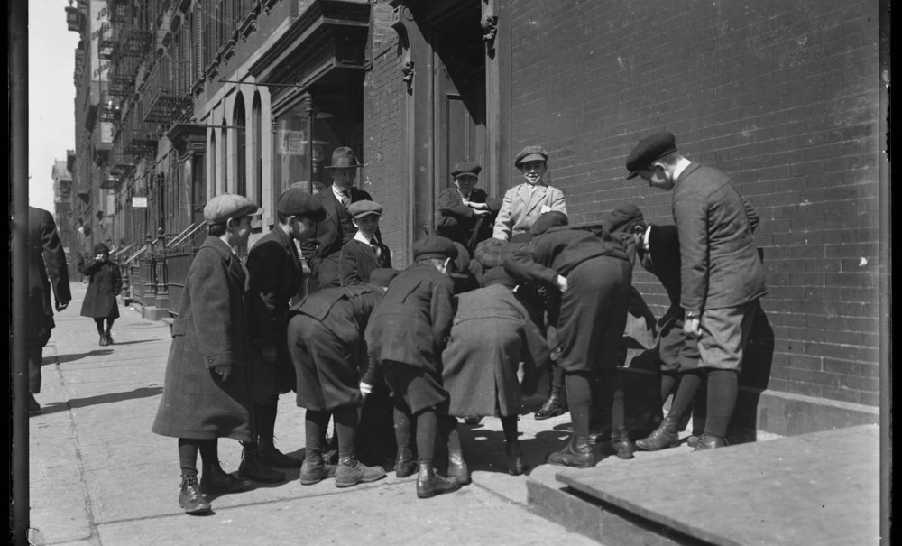 Group of unidentified boys playing a game (craps?) on the sidewalk, probably the Lower East Side, New York City, undated (ca. 1916)..jpg