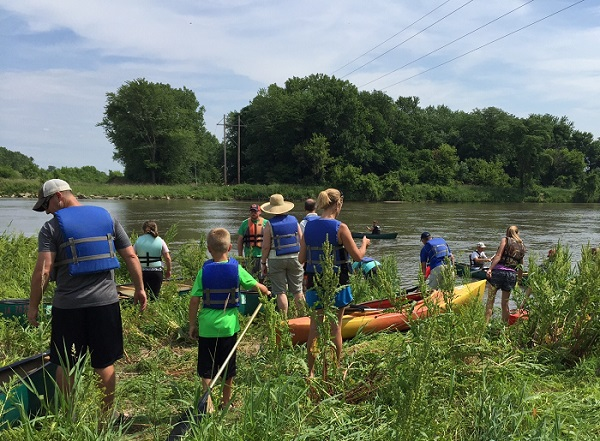 Participants prepare to put their canoes and kayaks in at the future site of the Todd Town Access during the Swinging Bridge Festival 2016.
