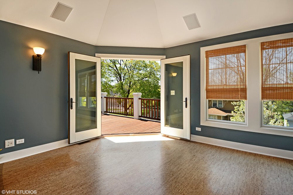 Wine Room & Second Floor Deck in this St. Charles IL River Home