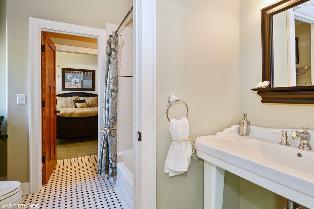 Chicago Style Bathroom with Old Style Pedestal Sinks with Legs