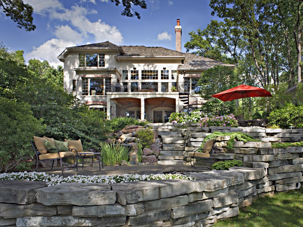 GENEVA IL. 60134 TEARDOWN AND REBUILD BY SOUTHAMPTON BUILDERS LLC. WITH RIVER & GOLF COURSE VEIWS. EXTENSIVE BLUESTONE TERRACED RETAINING WALLS WITH FALLING WATER PONDS.