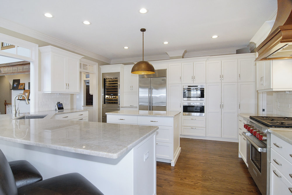 Custom Kitchen Remodel with New iceberg Quartzite. Copper Dome Light Over Island & Custom Designed Copper Hood. Custom Cabinetry & SubZero & Wolf Appliances. Looking for an Affordable Solution to Moving?