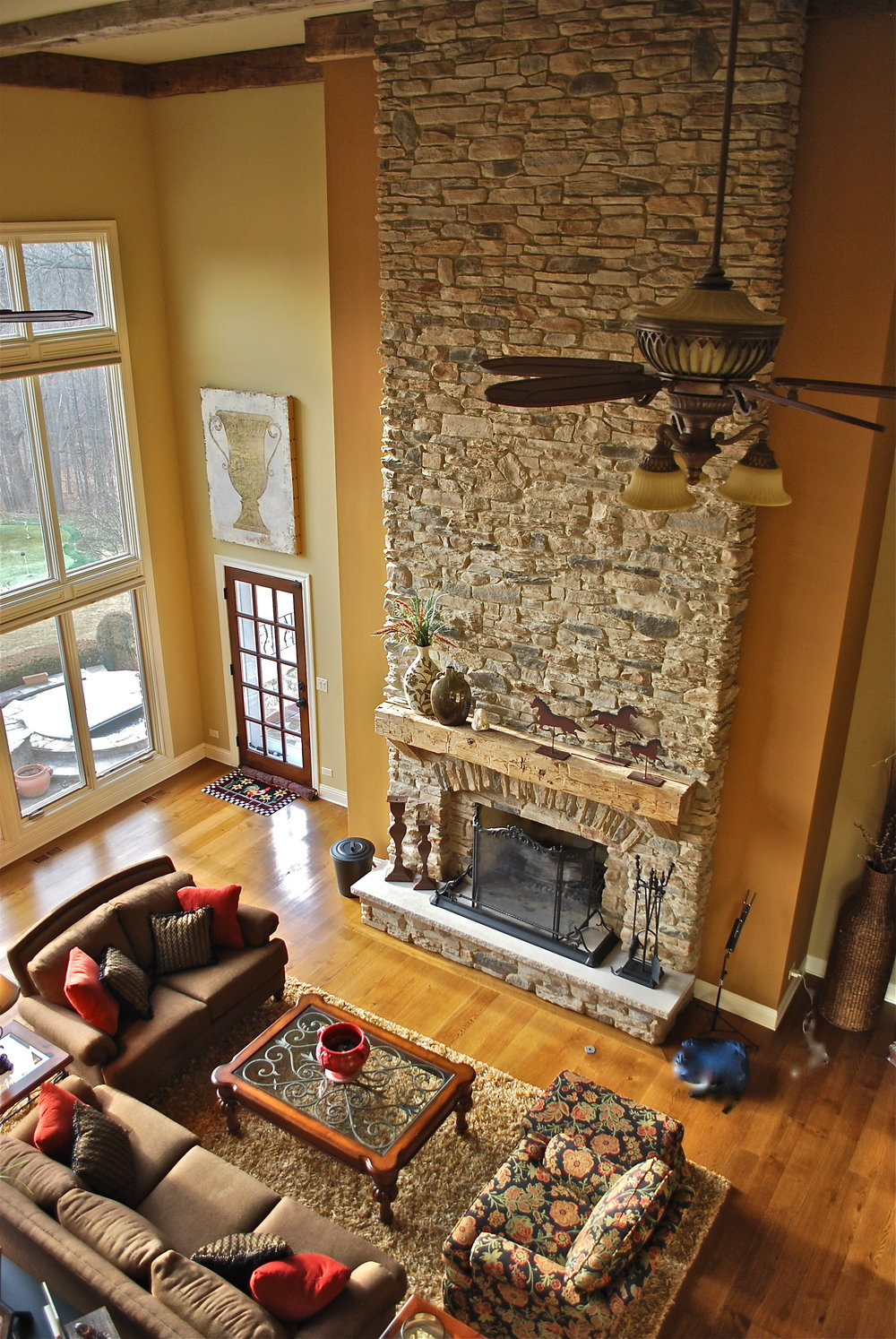 Massive Two Story Stacked Stone Fireplace Remodel