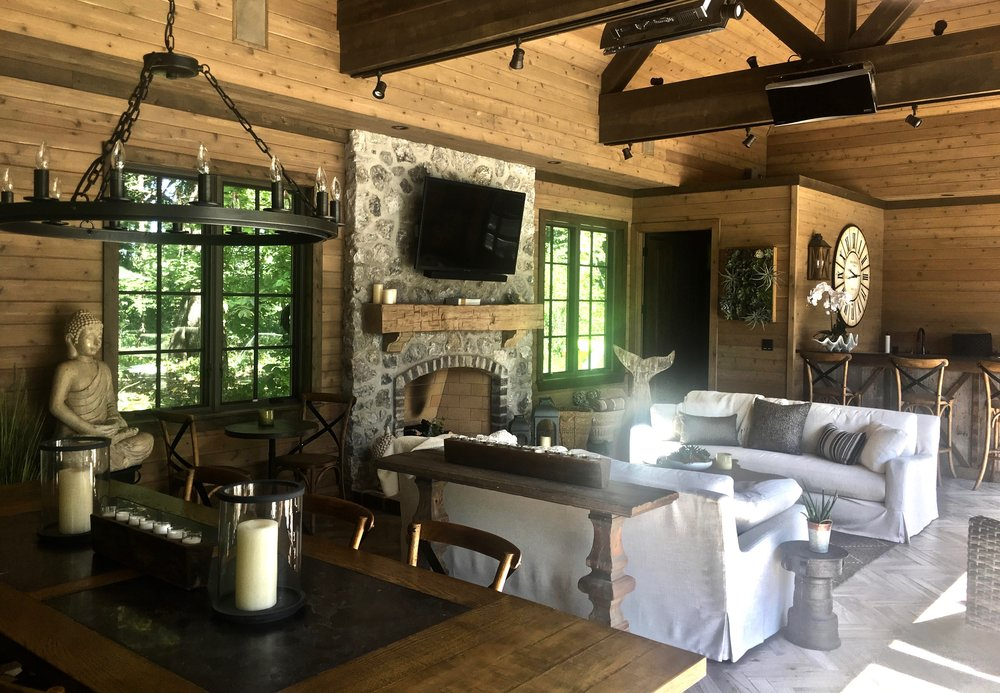 CUSTOM POOL HOUSE INTERIOR WITH FIREPLACE AND KITCHEN