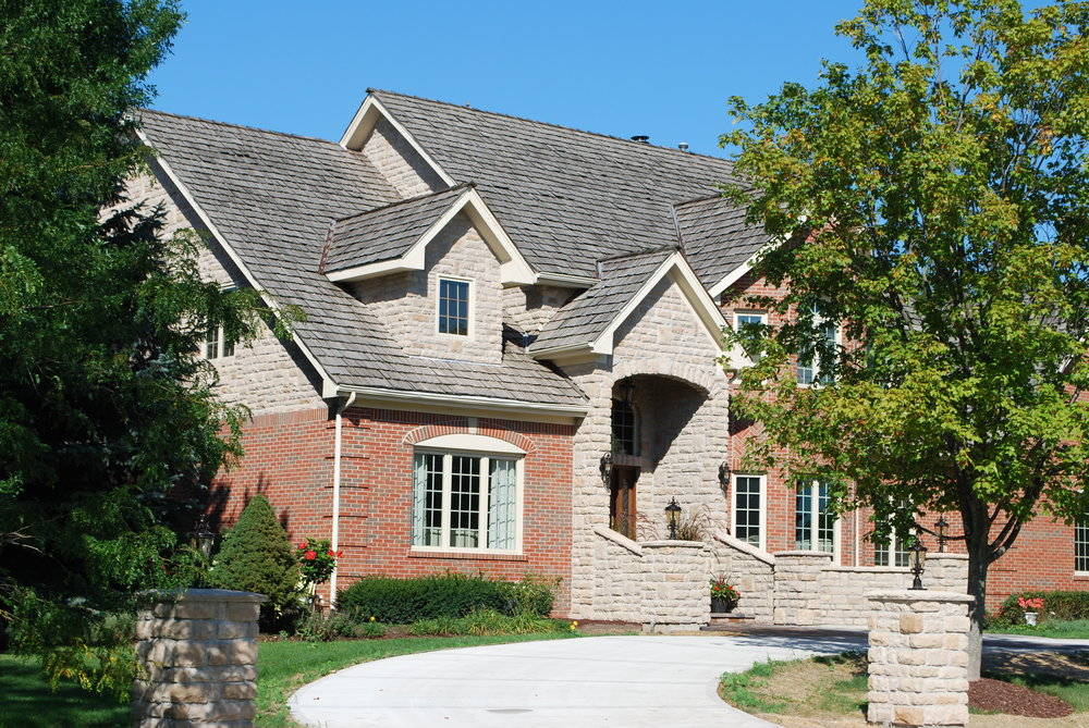 CUSTOM STONE PILLARS ADDED TO THIS CUSTOM HOME IN INVERNESS IL. CUSTOM ADDITION & EXTERIOR RENOVATIONS & UPDATING.