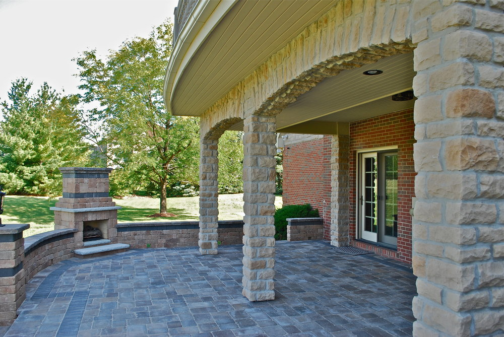 HOME ADDITIONS WITH STONE ARCHES & CUSTOM UNILOCK FIREPLACE & PATIO. ARCHED WATERPROOF DECK
