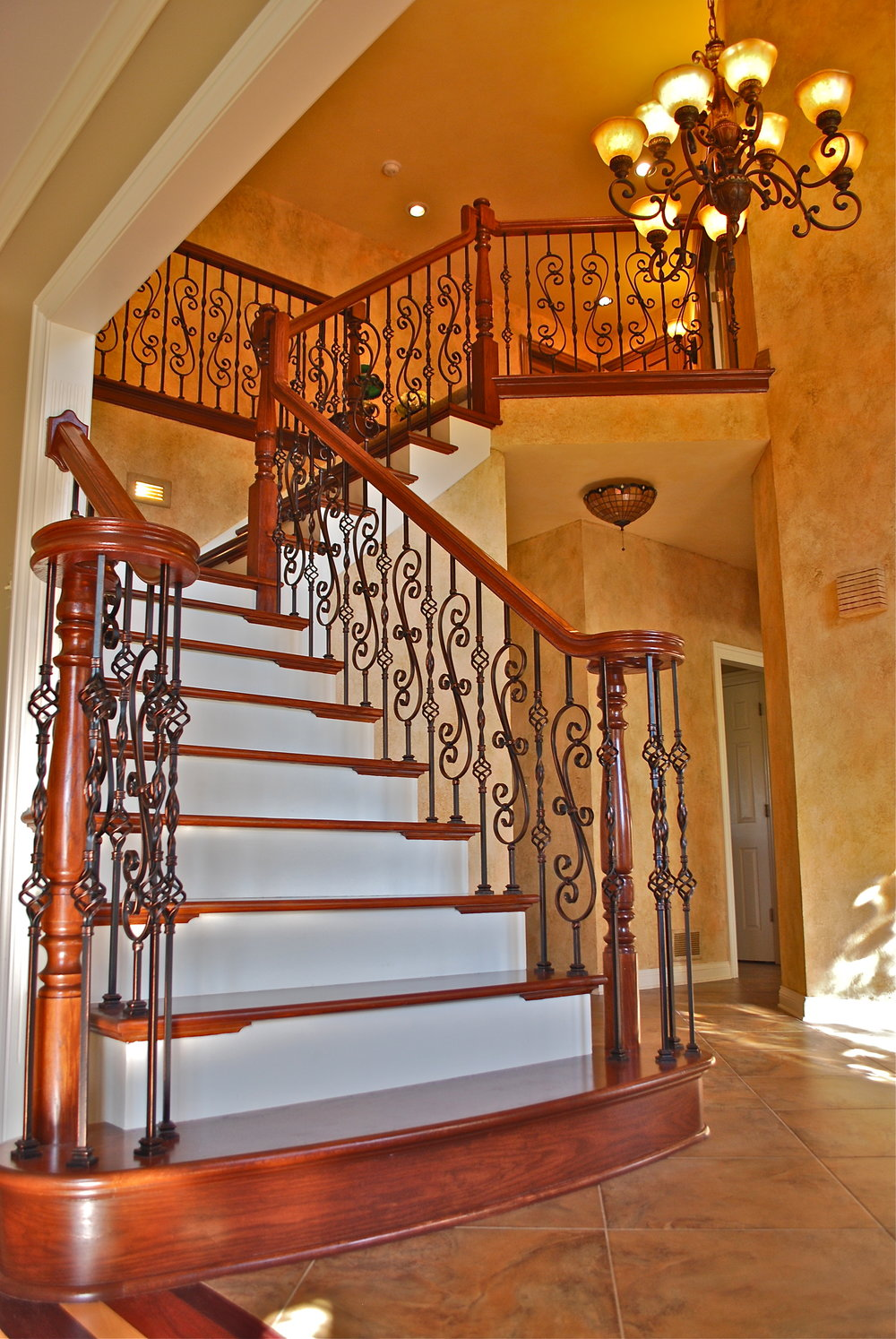 FOYER REMODEL & UPDATING BY SOUTHAMPTON BUILDERS LLC. NEW ARCHED STARTING FIRST STEP. STAIR CASE REMODEL IN GENEVA IL. BARRINGTON IL.