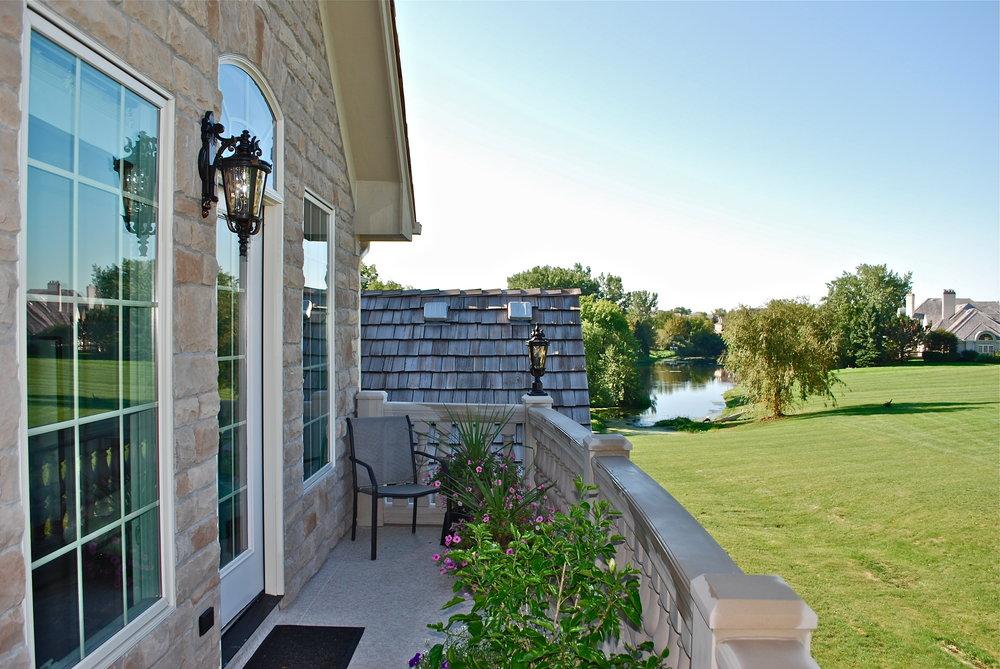 VIEW FROM THE HOME ADDITION & DECK. CURVED LIMESTONE HAND RAILS & BALUSTERS. BARRINGTON IL. LIMESTONE