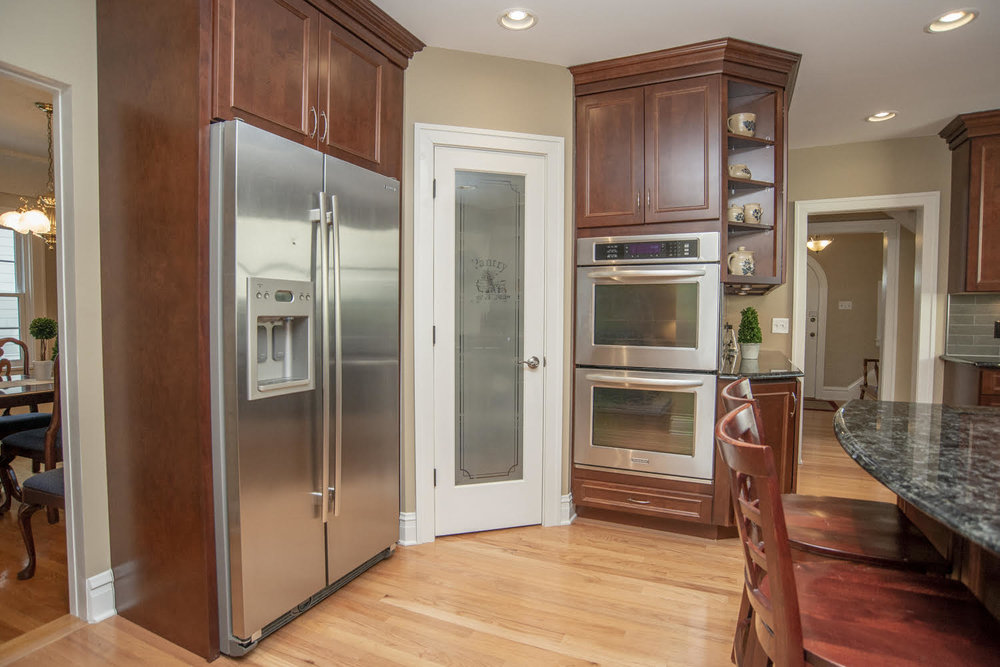 THIS WALK IN PANTRY WAS ADDED TO THIS CUSTOM KITCHEN REMODEL. MAKING ROOM FOR THE DOUBLE OVEN & FRIDGE OPENED UP THE REST OF THE KITCHEN FOR SEATING & AND ISLAND.
